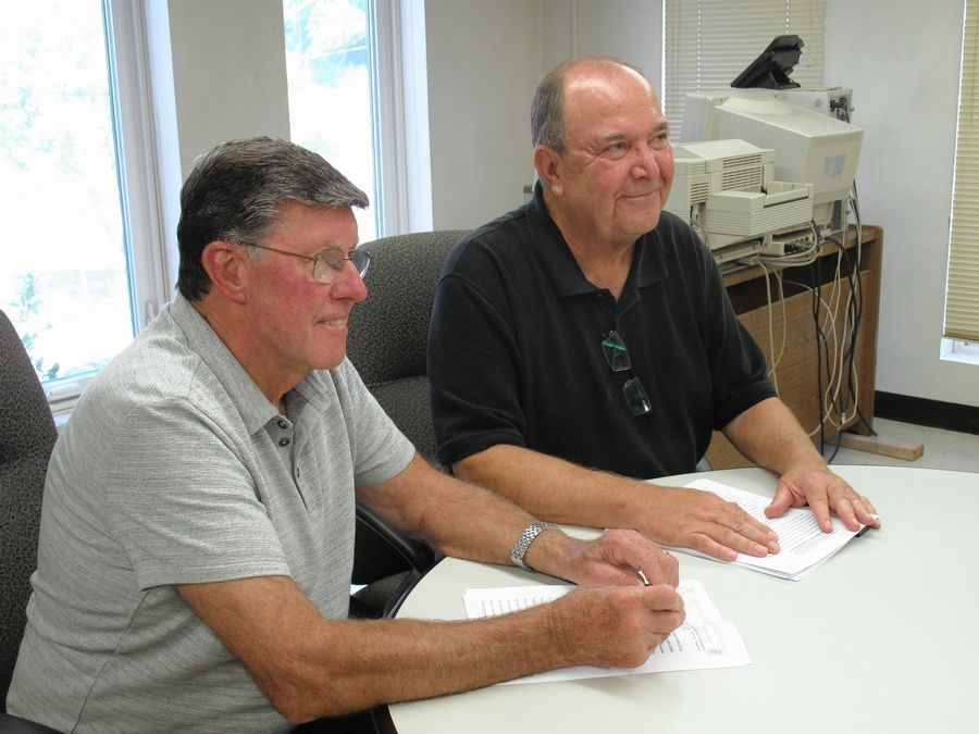 Naperville Township Highway Commissioner Stan Wojtasiak, left, and Lisle Township Highway Commissioner Ed Young discuss an agreement in which the Lisle Township road district will provide services for streets under the jurisdiction of the Naperville Township road district.