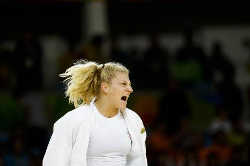 Harrison (AR) United States  city images : United States' Kayla Harrison reacts after defeating Slovenia's ...
