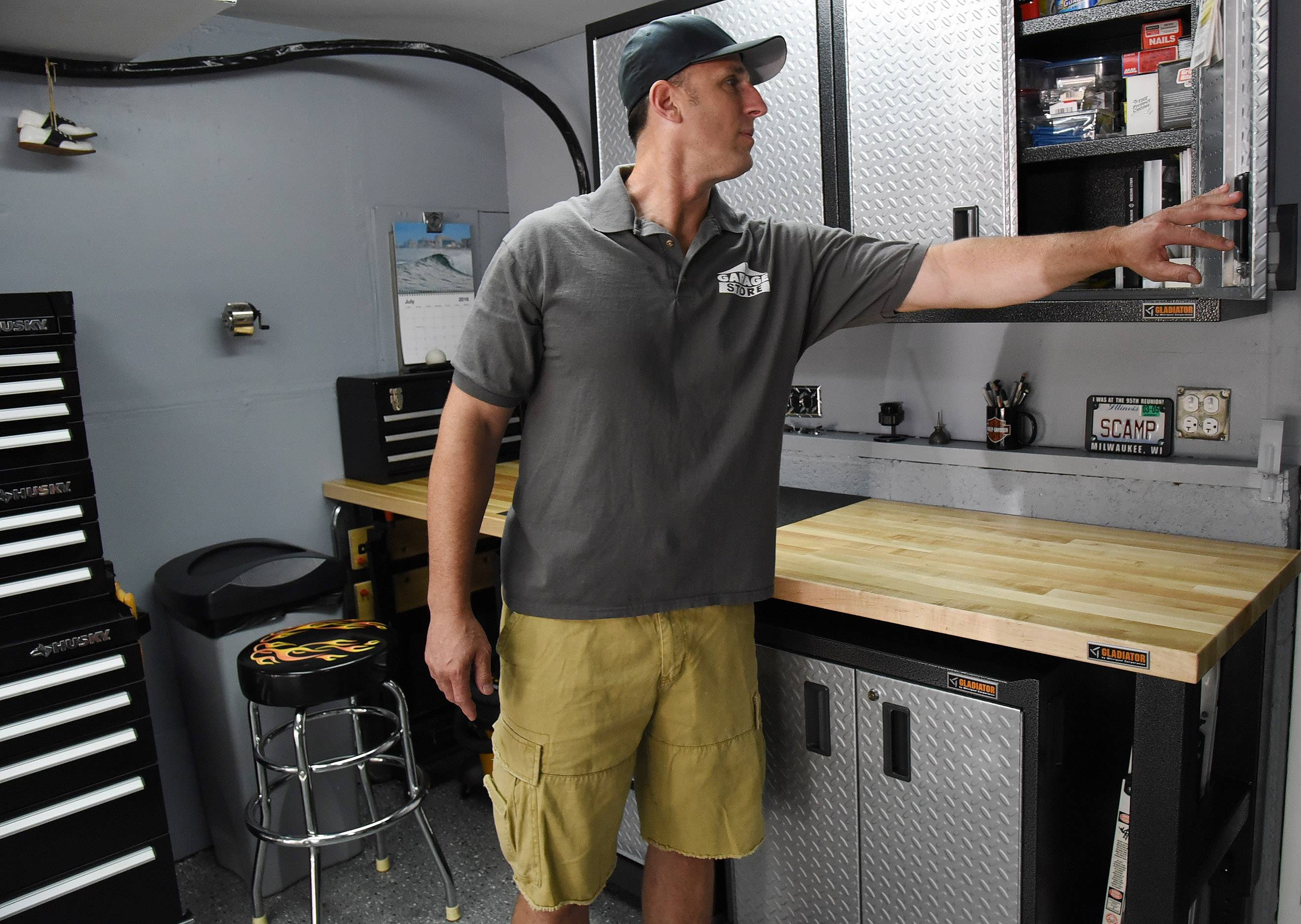 Jim Melchert of Garage Store inspects the completed makeover at Rob and Liz Ruisz's Schaumburg home.