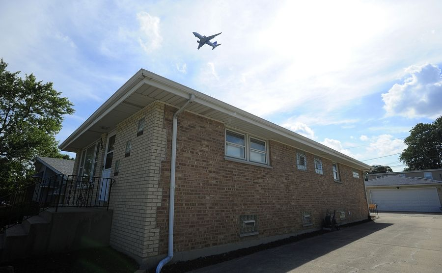 A jet passes over Wood Dale heading for a landing at O'Hare. A runway rotation test began July 6 following an uproar from residents affected by noisy, new flight patterns.