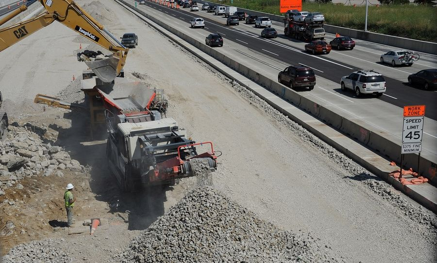 This mobile crusher pulverizes old concrete so that it can be used as a base for the new highway along the Jane Addams Tollway, here under the Meacham Road overpass in Schaumburg.
