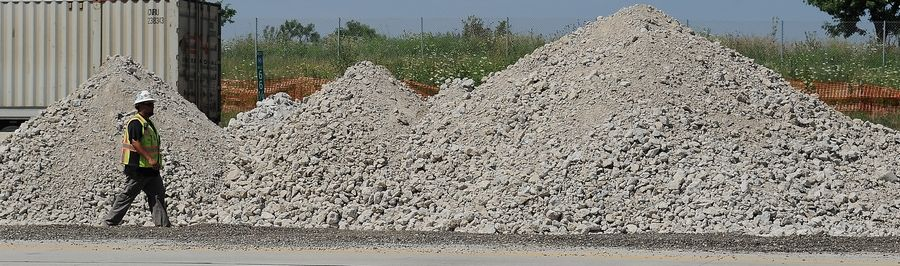 Concrete is crushed and used as a base for the new highway along the Jane Addams Tollway (I-90) at the Meacham Road overpass in Schaumburg.