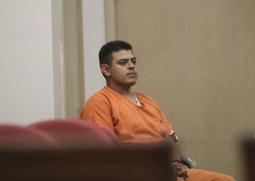 FILE--In this July 29, 2016, file photo, Edwin Lara, a security guard at Central Oregon Community College in Bend, Ore., waits in court in Yreka, Calif., for his arraignment. The murder of Kaylee Sawyer, from Bend, Ore., followed by a string of other crimes leading from Oregon through California allegedly committed by Lara has the scenic mountain town or Bend, Ore., deeply shaken. (Greg Barnette/The Record Searchlight via AP, file)
