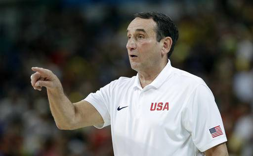United States head coach Mike Krzyzewski directs his team during a basketball game against France at the 2016 Summer Olympics in Rio de Janeiro, Brazil, Sunday, Aug. 14, 2016. (AP Photo/Charlie Neibergall)