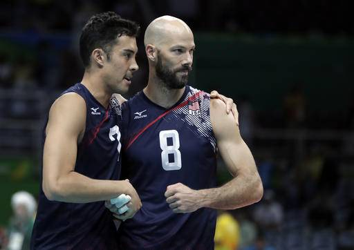 United States' Kawika Shoji, left, and William Reid Priddy shake hands after defeating Mexico during a men's preliminary volleyball match at the 2016 Summer Olympics in Rio de Janeiro, Brazil, Monday, Aug. 15, 2016. (AP Photo/Jeff Roberson)