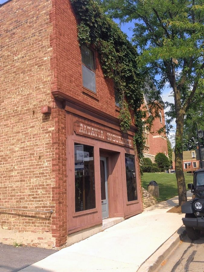 The city of Batavia has postponed the vote Monday on whether to buy this building, at 121 E. Wilson St., to make way for the One North Washington Place development.