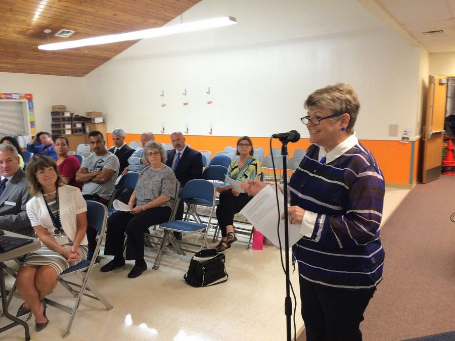Round Lake Area Schools Education Foundation board member Judy Armstrong announces a fundraising initiative called Club 116. She spoke at Monday night's Round Lake Area Unit District 116 board meeting.