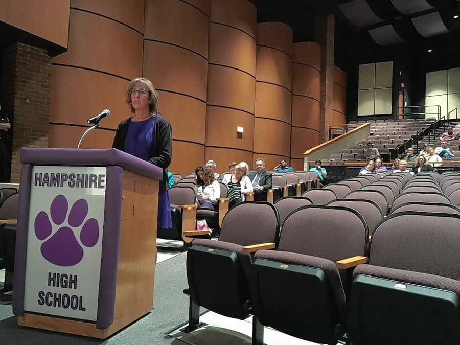 Sylvia Polletta, the new chief executive officer and chief operating officer for Northern Kane Educational Corp., which manages Cambridge Lakes Charter School in Pingree Grove, addresses concerns Wednesday over the school's opening on Sept. 6 being delayed due to a non-permitted construction project.