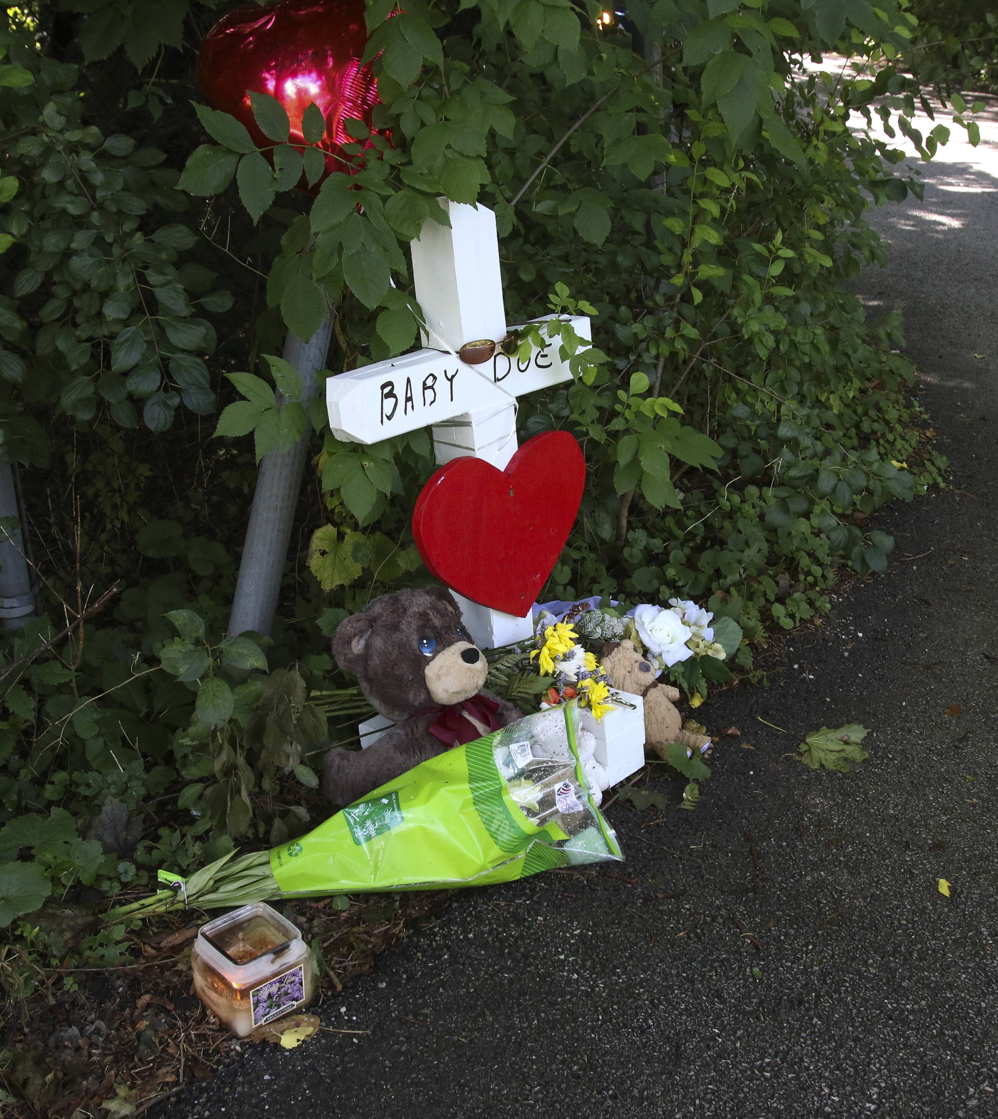 Fresh flowers and stuffed animals have marked the scene, all week, where Baby Hope was found dead Monday in Wheaton.