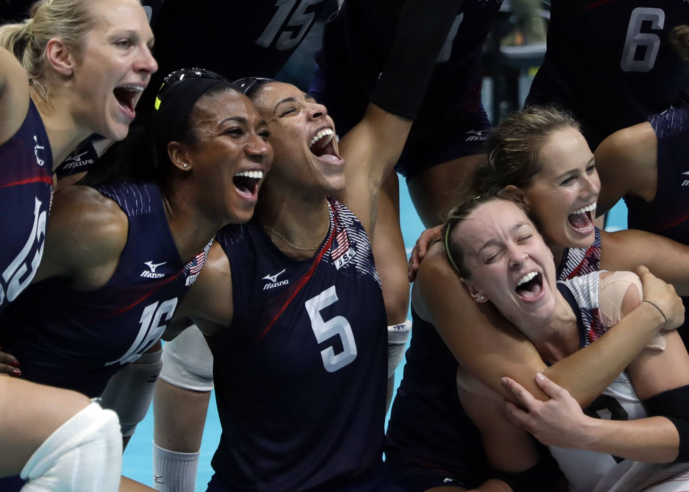 Members of the United States team celebrate after defeating the Netherlands during a women's bronze medal volleyball match at the 2016 Summer Olympics in Rio de Janeiro, Brazil, Saturday, Aug. 20, 2016. The United States won 3-1.