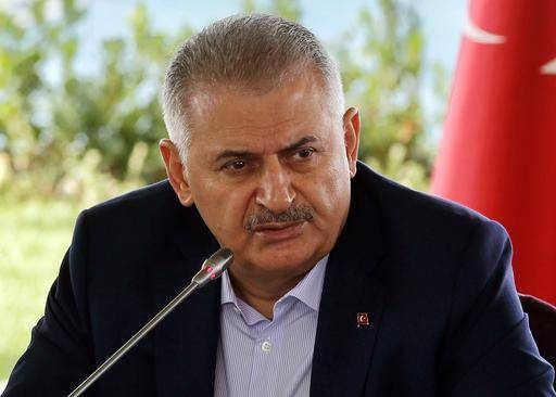 Turkish Prime Minister Binali Yildirim speaks during a meeting with foreign media representatives in Istanbul, Saturday, Aug. 20, 2016. Yildirim says his country is willing to accept a role for Syrian President Bashar Assad during a transitional period in Syria. (Prime Minister Press Service via AP)