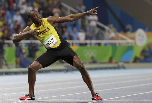 FILE - In this Aug. 18, 2016 file photo, Usain Bolt from Jamaica celebrates winning the gold medal in the men's 200-meter final during the athletics competitions of the 2016 Summer Olympics at the Olympic stadium in Rio de Janeiro, Brazil. (AP Photo/David J. Phillip, File)