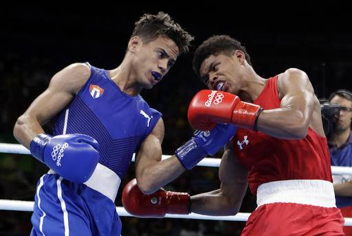 Cuba's Robeisy Ramirez, left, and United States' Shakur Stevenson exchange punches during a men's bantamweight 56-kg final boxing match at the 2016 Summer Olympics in Rio de Janeiro, Brazil, Saturday, Aug. 20, 2016. (AP Photo/Frank Franklin II)