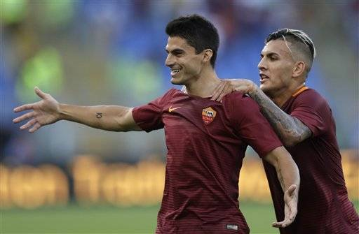 Roma's Diego Perotti, left, celebrates with teammate Leandro Paredes after scoring during a Serie A soccer match between Roma and Udinese, at Rome's Olympic stadium, Saturday, Aug. 20, 2016. (AP Photo/Alessandra Tarantino)