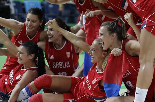 Members of the Serbia basketball team celebrate their win over France in a women's bronze medal basketball game at the 2016 Summer Olympics in Rio de Janeiro, Brazil, Saturday, Aug. 20, 2016. (AP Photo/Eric Gay)