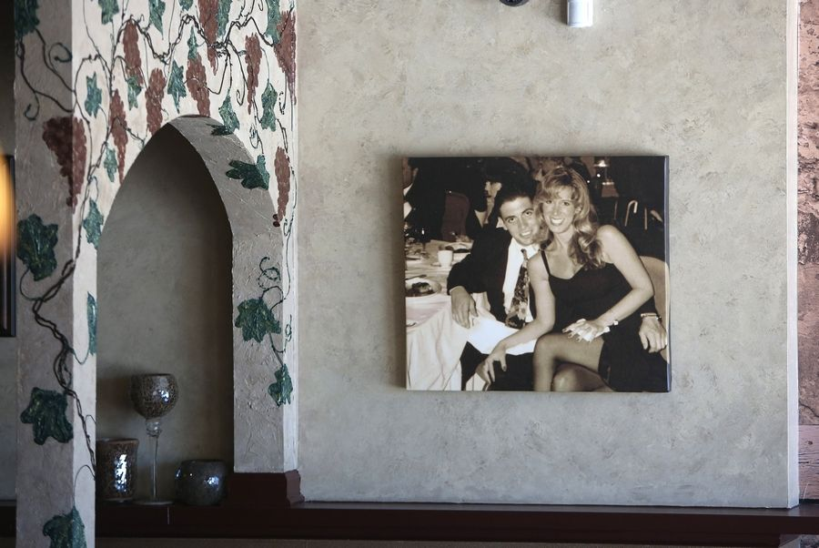 A picture of owners Phil and Tina Gilardi hangs inside Tina G's, in Mundelein.