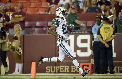 FILE - In this Aug. 19, 2016, file photo, New York Jets wide receiver Robby Anderson (83) crosses the goal line for a touchdown during the second half of an NFL preseason football game against the Washington Redskins, in Landover, Md. Robby Anderson had a breakout performance for the Jets last Friday night with six catches for 131 yards and a touchdown against the Redskins. (AP Photo/Nick Wass, File)