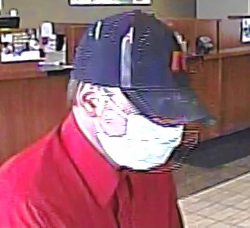 A surveillance image shows a man wearing a surgical mask who robbed a bank Tuesday in Carol Stream, authorities said.