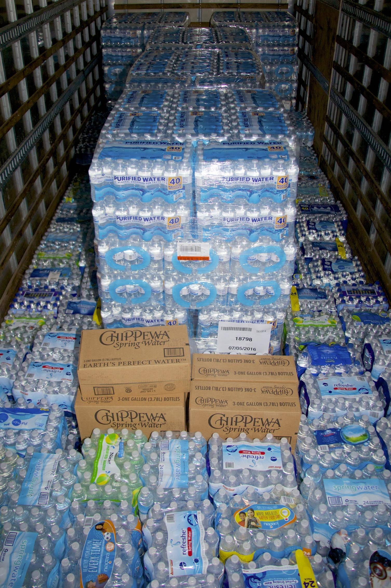 Bottled water is stacked in truck heading to Flint, Michigan.