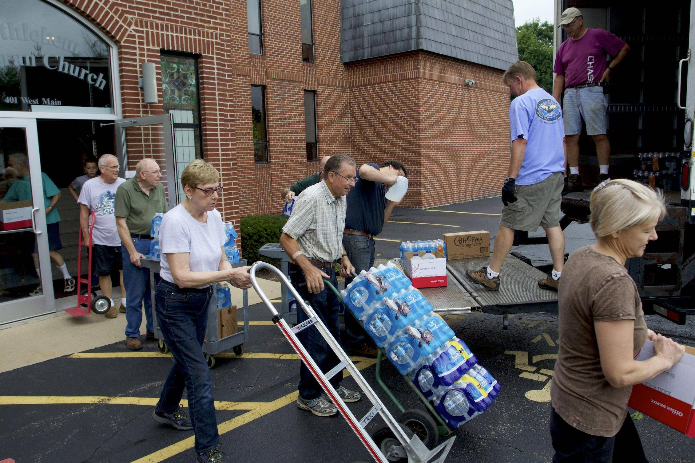 Volunteers from Bethlehem Lutheran Church in West Dundee load bottled water into a truck heading to Flint, Michigan.