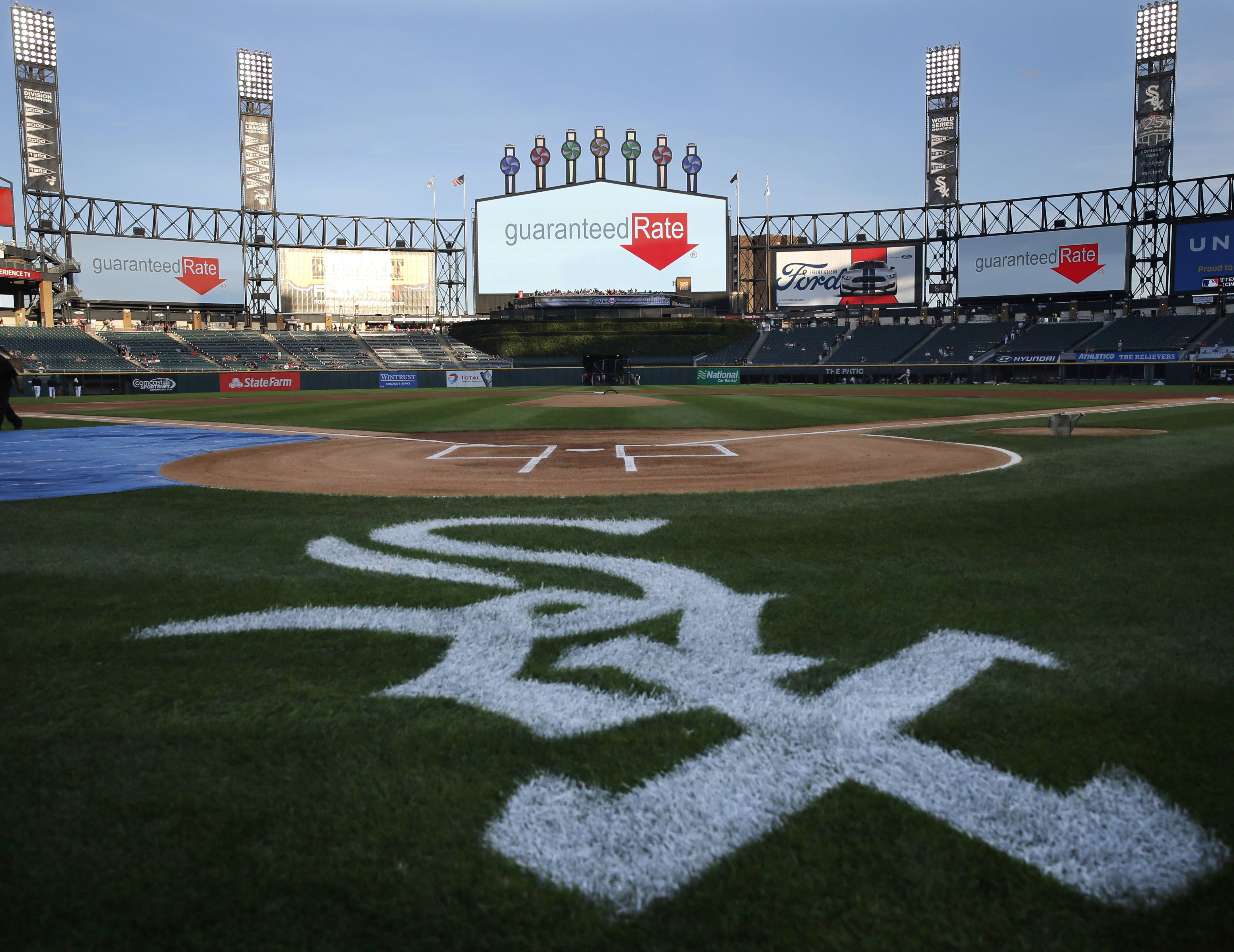 The Chicago White Sox logo is painted behind home plate at U.S. Cellular Field before a baseball game between the Chicago White Sox and the Philadelphia Phillies on Wednesday, Aug. 24, 2016, in Chicago. U.S. Cellular Field will become known as Guaranteed Rate Field starting in November. The team and the mortgage company announced a 13-year naming rights deal on Wednesday. The ballpark has been named U.S. Cellular Field since 2003 after being called new Comiskey Park from 1991 to 2002. (AP Photo/Charles Rex Arbogast)