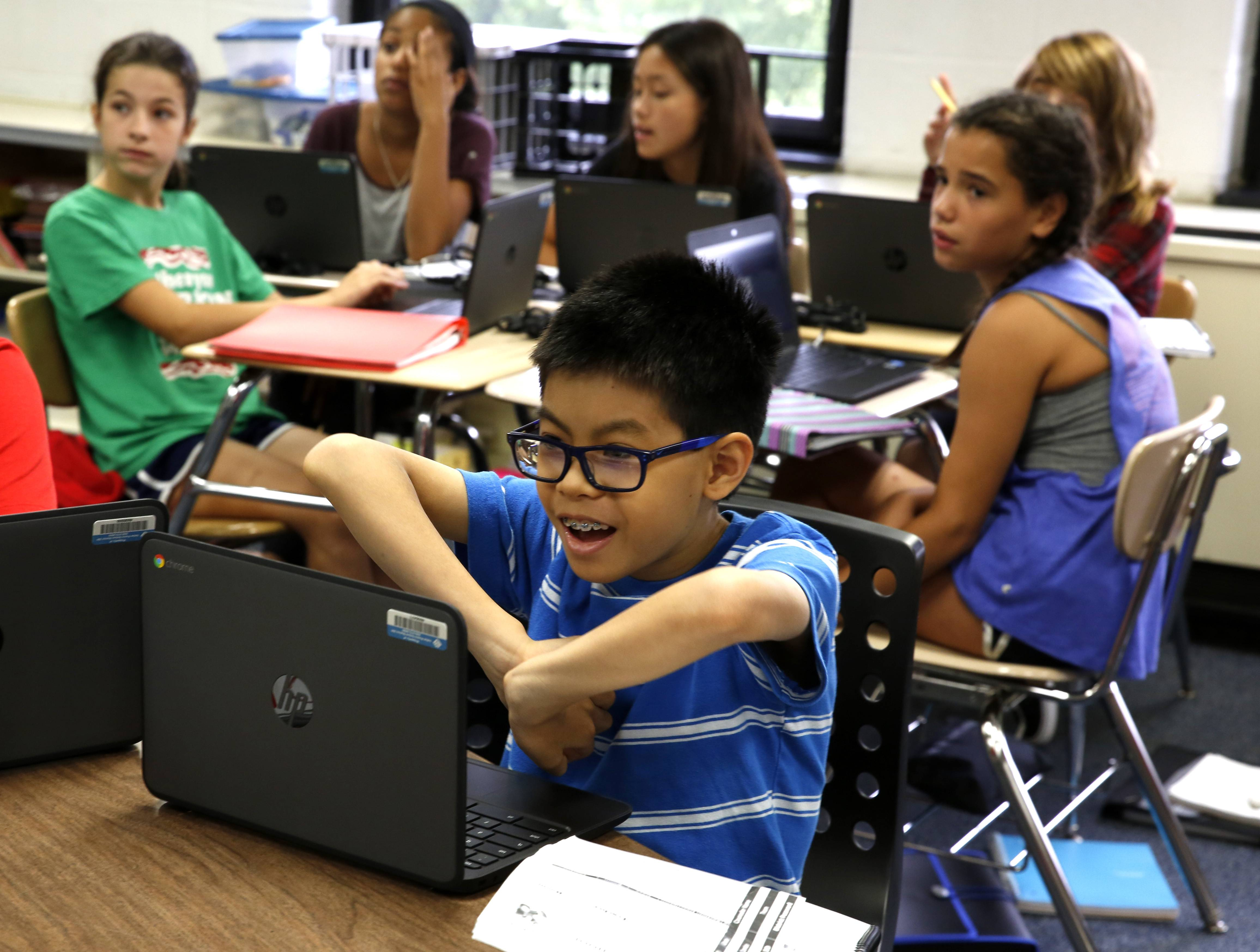 Gregory Middle School student Malcolm Low logs into his new personal Chromebook, which he and about half of the 7,000 middle schoolers in Indian Prairie Unit District 204 received Thursday. Students in sixth through eighth grade are the first in the district to each be given their own computing device.