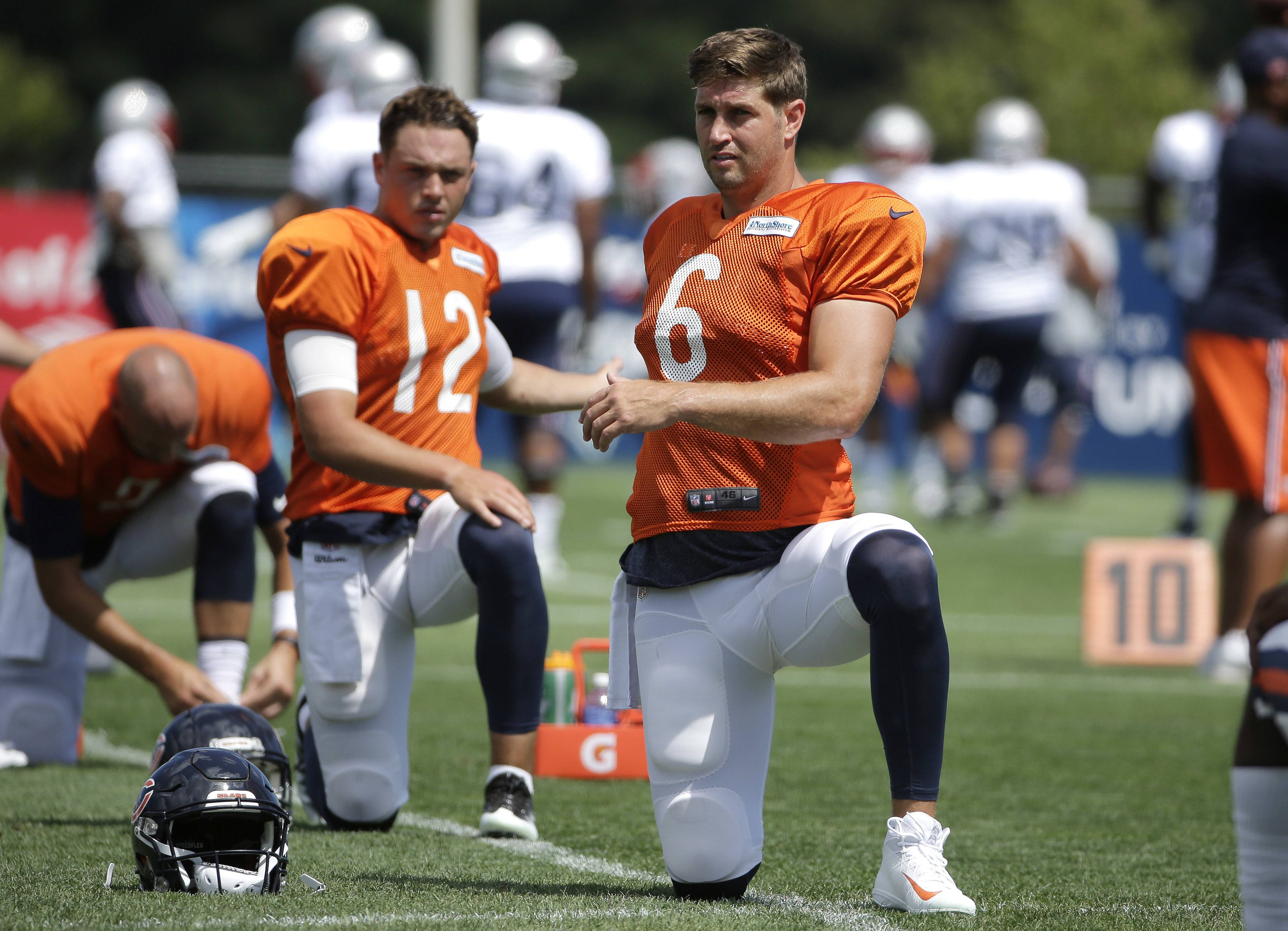 Chicago Bears quarterbacks David Fales (12) and Jay Cutler (6) warm up on the field during an NFL football training camp practice with the New England Patriots, Monday, Aug. 15, 2016, in Foxborough, Mass.
