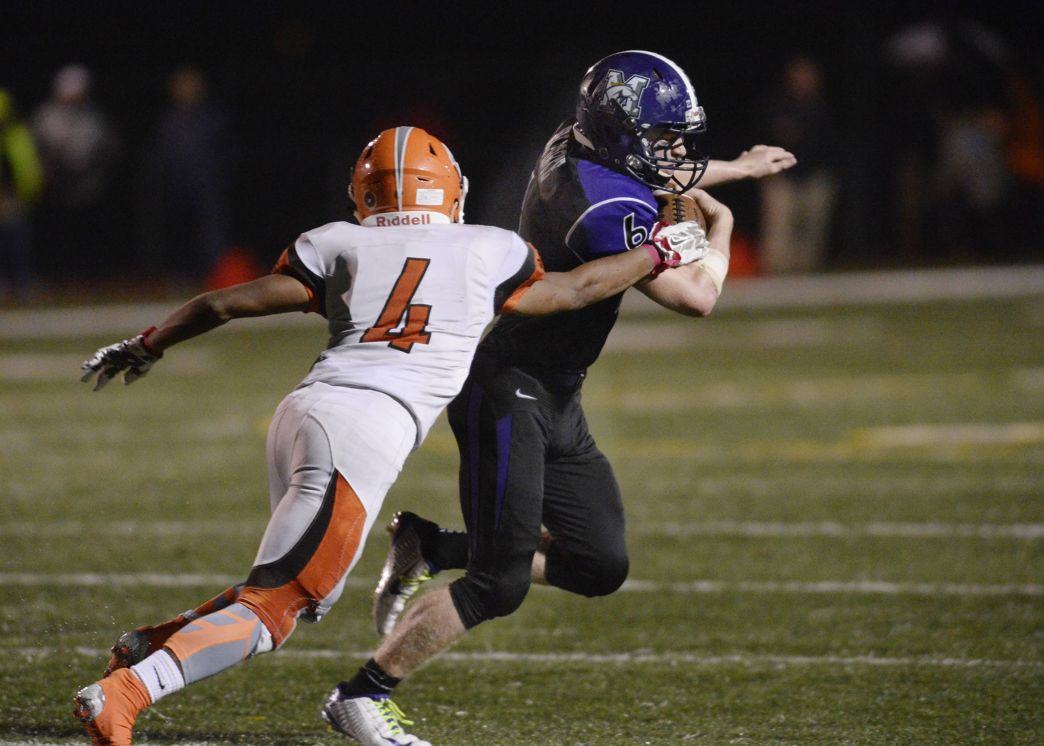 Rolling Meadows' Nick Delporte sheds Hersey defenders on his way to a TD last season. Delporte, a three-year starter for the Mustangs, will be in action in Friday's nonconference season opener hosted by St. Viator.