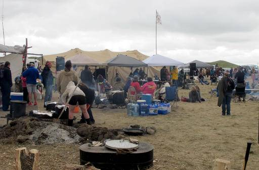 People protesting the construction on a four-state oil pipeline at a site in southern North Dakota gather at campground near the Standing Rock Sioux reservation on Thursday, Aug. 25, 2016. About 300 people were at the campsite where protesters from across the country and members of 60 tribes have gathered in opposition to the $3.8 billion Dakota Access pipeline that will pass through Iowa, Illinois, North Dakota and South Dakota. (AP Photo/James MacPherson)