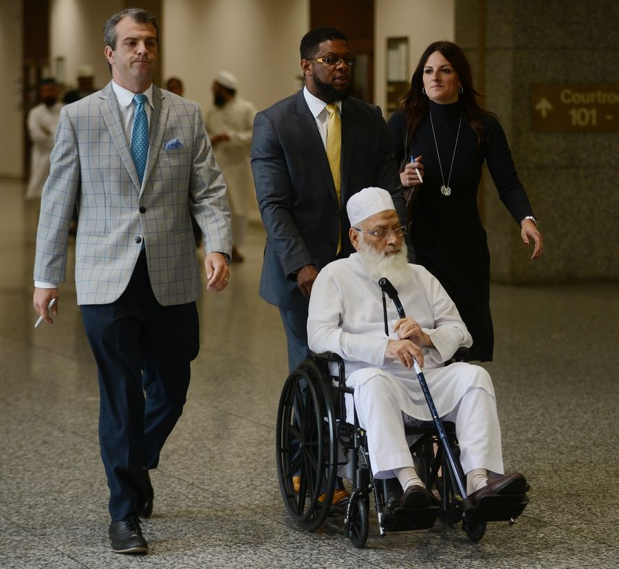 Mohammed Abdullah Saleem, front, leaves the Rolling Meadows courthouse Thursday. His attorney, Donna Rotunno, is at right.
