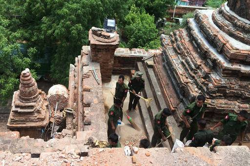 Military personnel clear debris at a temple that was damaged by a strong earthquake in Bagan, Myanmar, Thursday, Aug. 25, 2016. Using brooms and their hands soldiers and residents of the ancient Myanmar city famous for it's historic Buddhist pagodas, began cleaning up the debris from a powerful earthquake that shook the region and damaged nearly 200 temples Wednesday. (AP Photo/Min Kyi Thein)