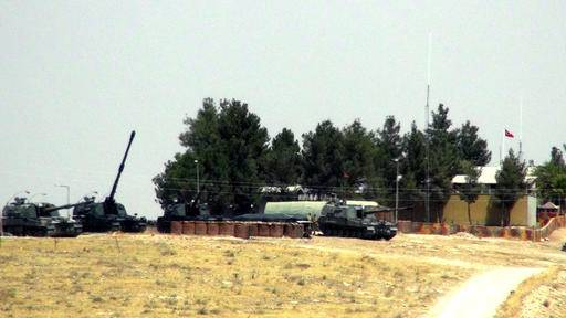Turkish tanks stationed near the Syrian border in Karkamis, Turkey, Wednesday, Aug. 24, 2016. Turkey's military launched an operation before dawn Wednesday aimed at clearing a Syrian border town from Islamic State militants, and a private Turkish TV station reported that a small number of Turkish special forces had crossed into Syria as part of the operation. (AP Photo)