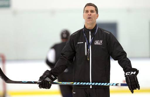 Lake Erie Monsters hockey coach Jared Bednar watches during practice at the OBM Arena in Strongsville, Ohio, Oct. 7, 2015. The Colorado Avalanche have hired Bednar as their new head coach. Bednar replaces Patrick Roy, who abruptly stepped down as coach and vice president of hockey operations earlier this month. The 44-year-old Bednar won the American Hockey League's Calder Cup championship as coach of the Lake Erie Monsters last season. (Chuck Crow/The Plain Dealer via AP)