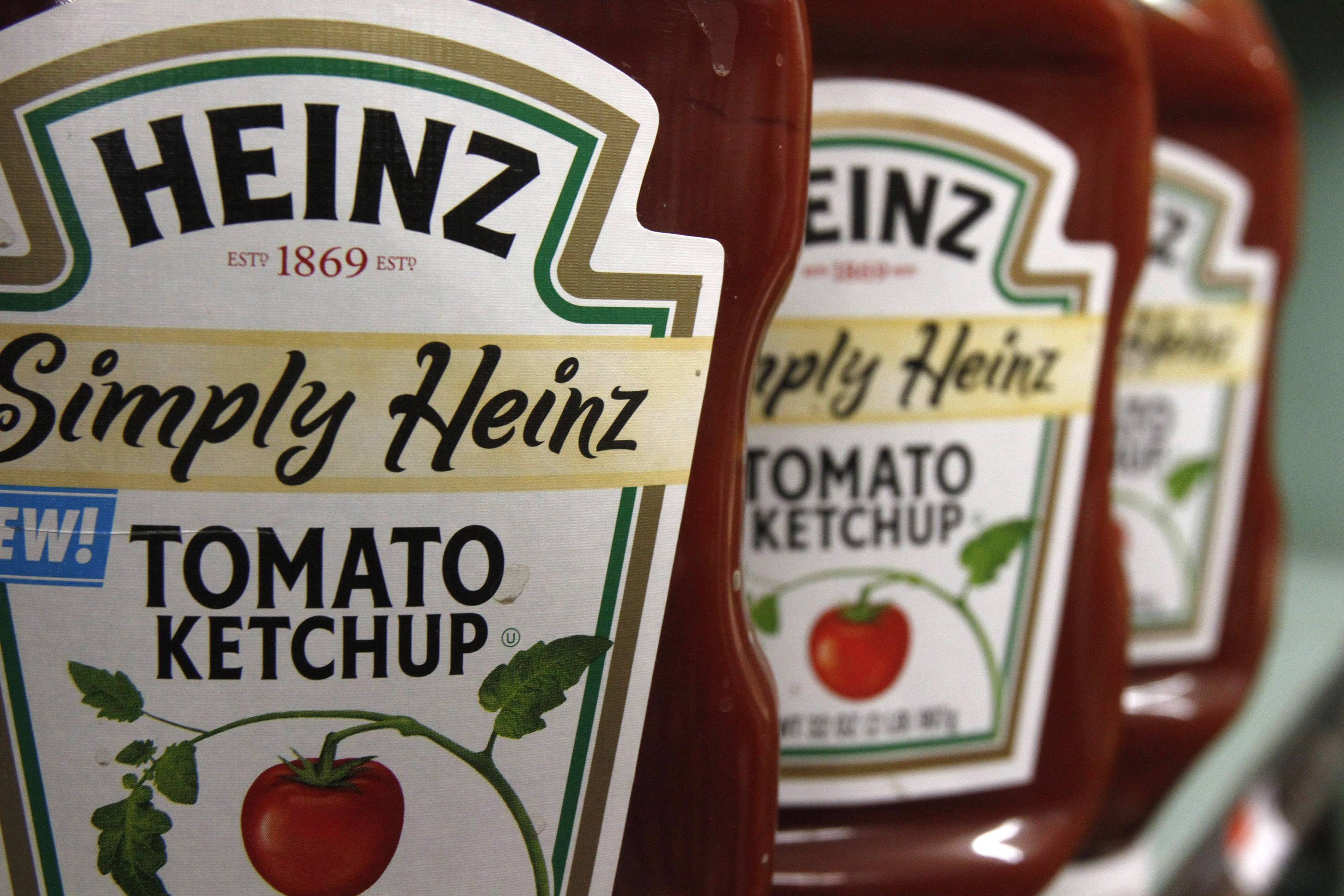 Kraft Heinz, makers of Kraft Macaroni & Cheese and Heinz Ketchup and other foods, said it will lay off about 200 workers in the United States and Canada.