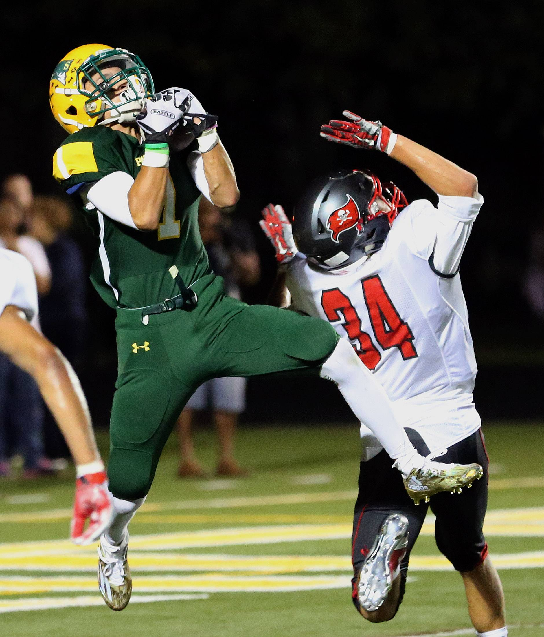 Stevenson's Noah Lukz, left, catches a pass for a touchdown on Palatine's John Streepy.