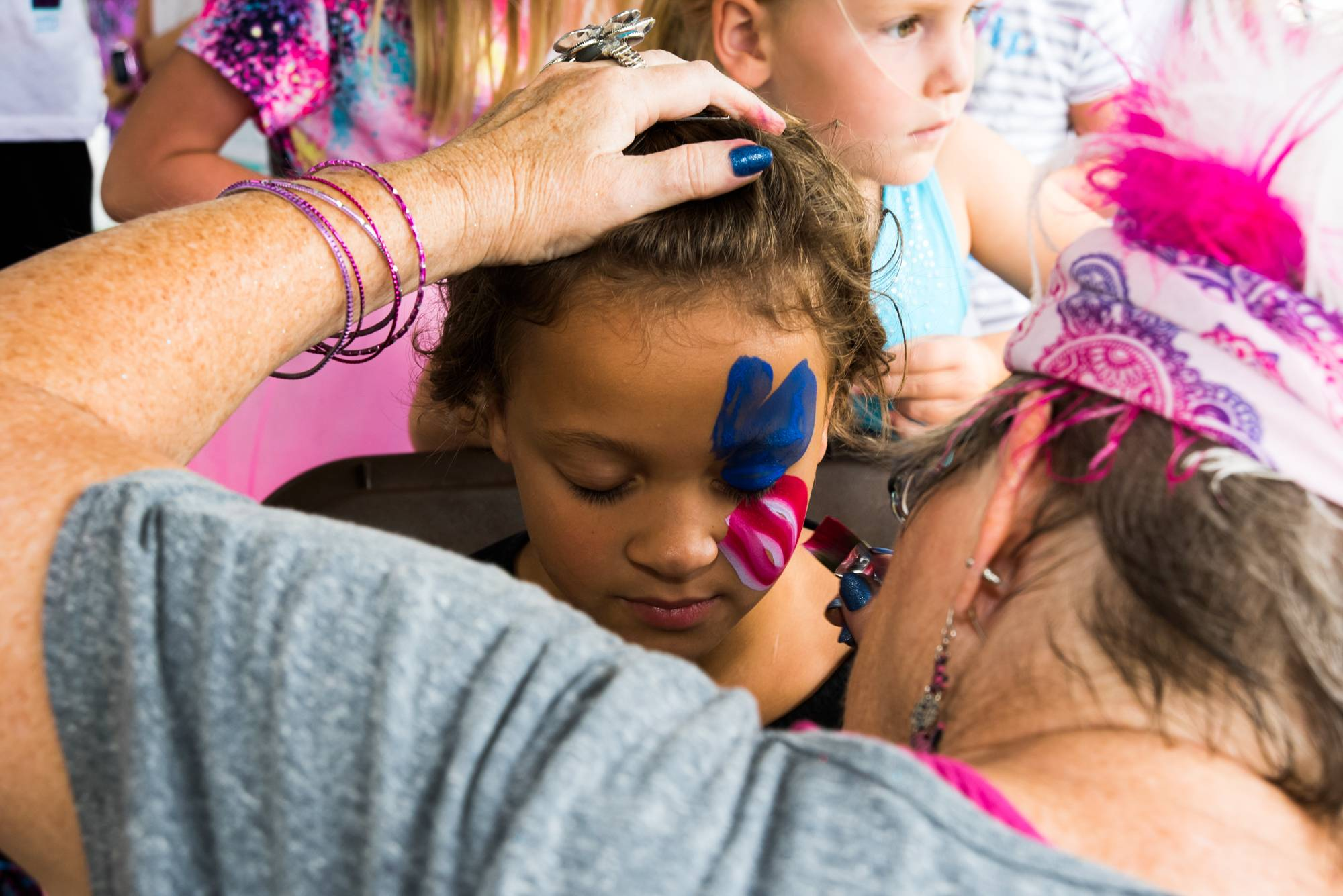 Hazyl Campbell holds perfectly still for face-painting Saturday at the Downtown Palatine Street Fest.