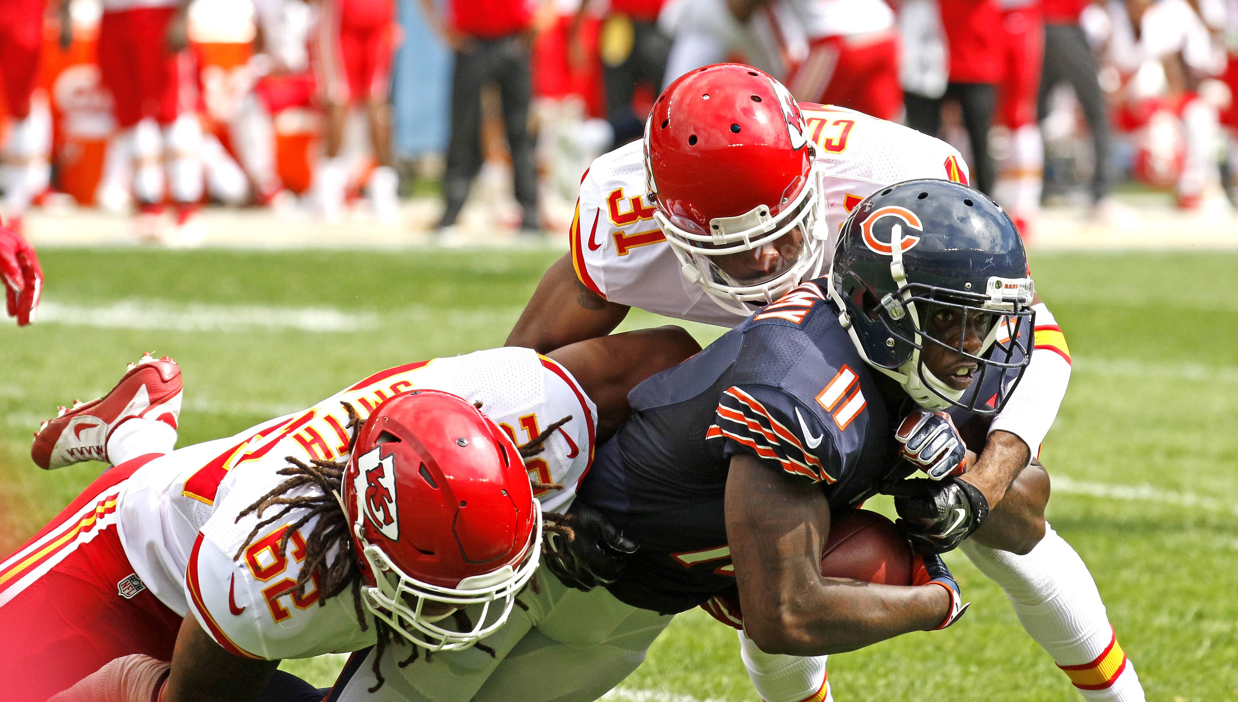 Daniel White/dwhite@dailyherald.com Bears wide receiver Joshua Bellamy is tackled by the Kansas City Chiefs' Terrance Smith and Marcus Cooper during a preseason game Saturday at Soldier Field. The Bears lost 23-7.