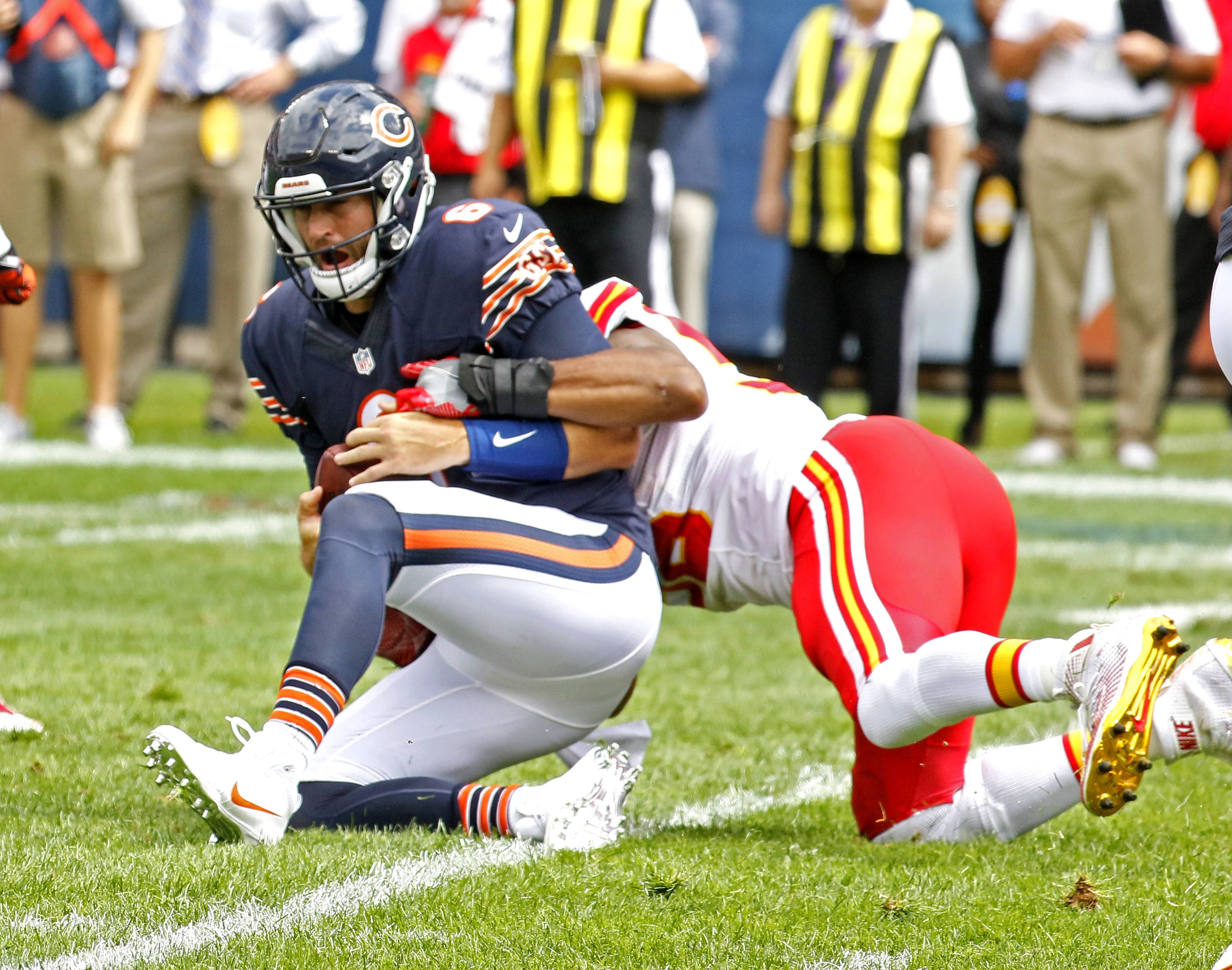 Chicago Bears quarterback Jay Cutler is sacked by the Kansas City Chiefs Derrick Johnson during a preseason game Saturday at Soldier Field.