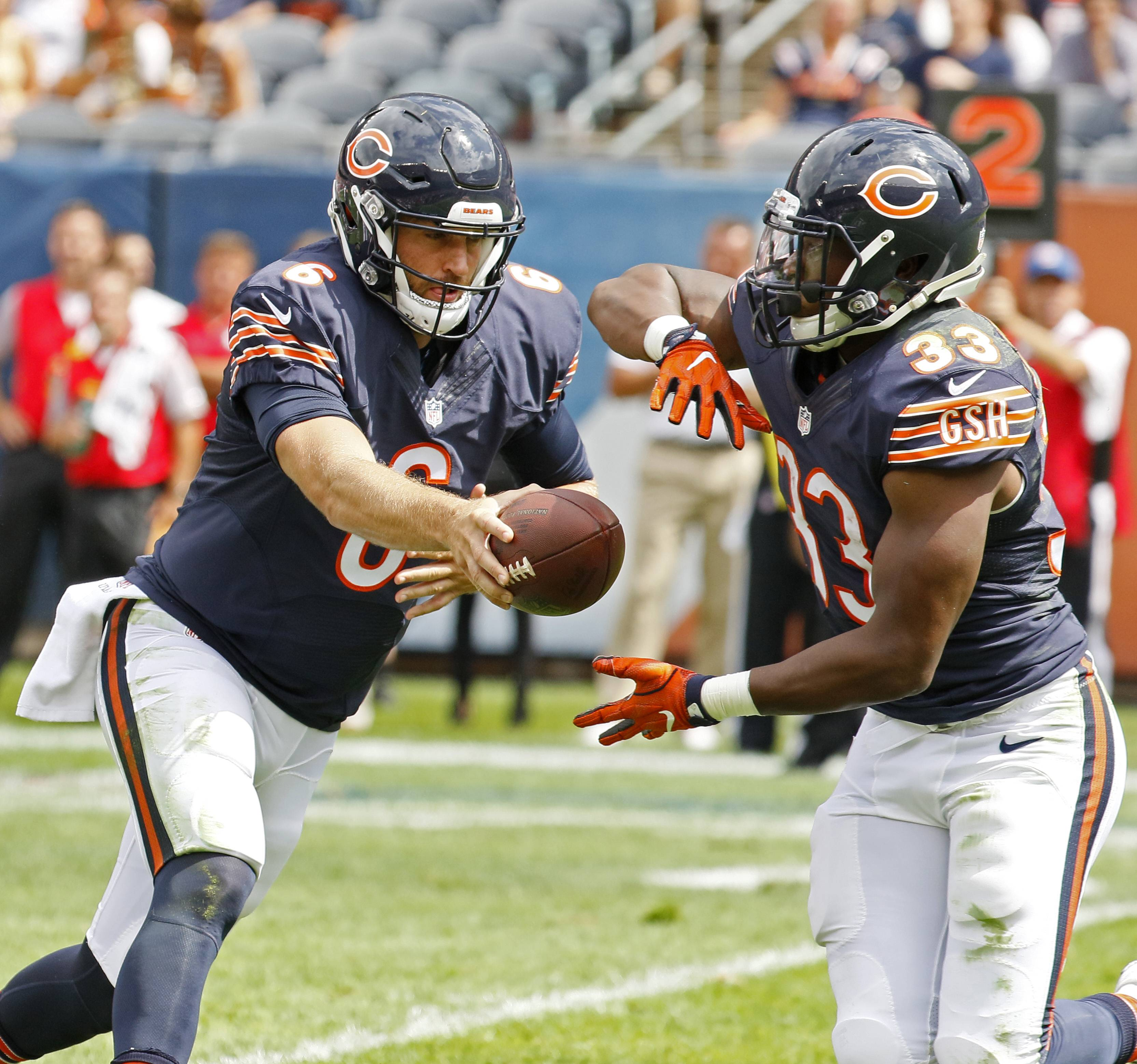 Chicago Bears quarterback Jay Cutler hands the ball to Jeremy Langford against the Kansas City Chiefs during a preseason game, Saturday, August 27, 2016 at Soldier Field.