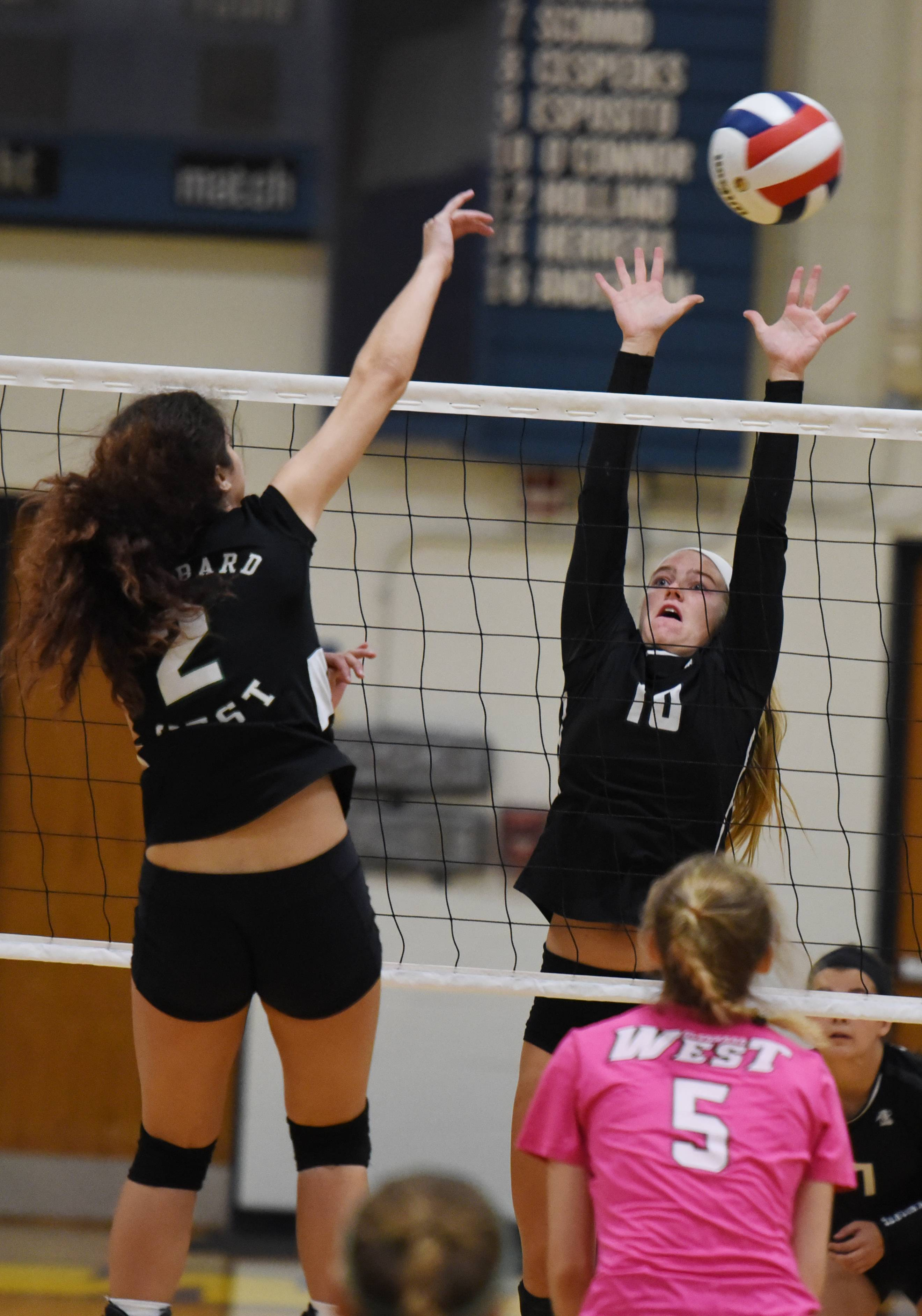 Paul Michna/pmichna@dailyherald.comSophia Alles of Glenbard West,left, blocks a shot from Hannah Nauert of Kaneland during game action at Wheaton North Saturday.