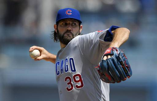 Chicago Cubs starting pitcher Jason Hammel throws to the plate during the first inning of a baseball game against the Los Angeles Dodgers, Saturday, Aug. 27, 2016, in Los Angeles. (AP Photo/Mark J. Terrill)