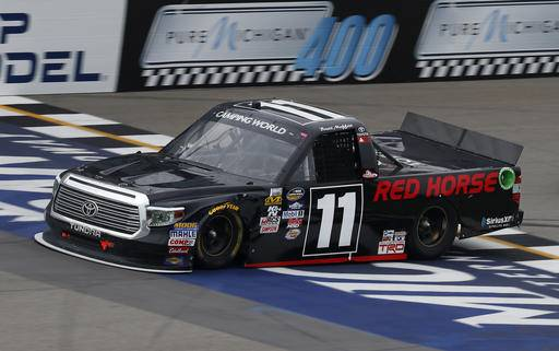 Brett Moffitt crosses the finish line to win the NASCAR Camping World Truck Series auto race at Michigan International Speedway, in Brooklyn, Mich., Saturday, Aug. 27, 2016. (AP Photo/Paul Sancya)