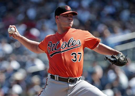 5d2325223 ... Baltimore Orioles pitcher Dylan Bundy delivers a during the fourth  inning of a baseball game against ...