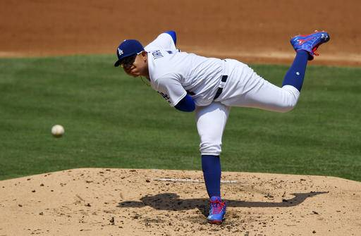Los Angeles Dodgers starting pitcher Julio Urias throws to the plate during the second inning of a baseball game against the Chicago Cubs, Saturday, Aug. 27, 2016, in Los Angeles. (AP Photo/Mark J. Terrill)