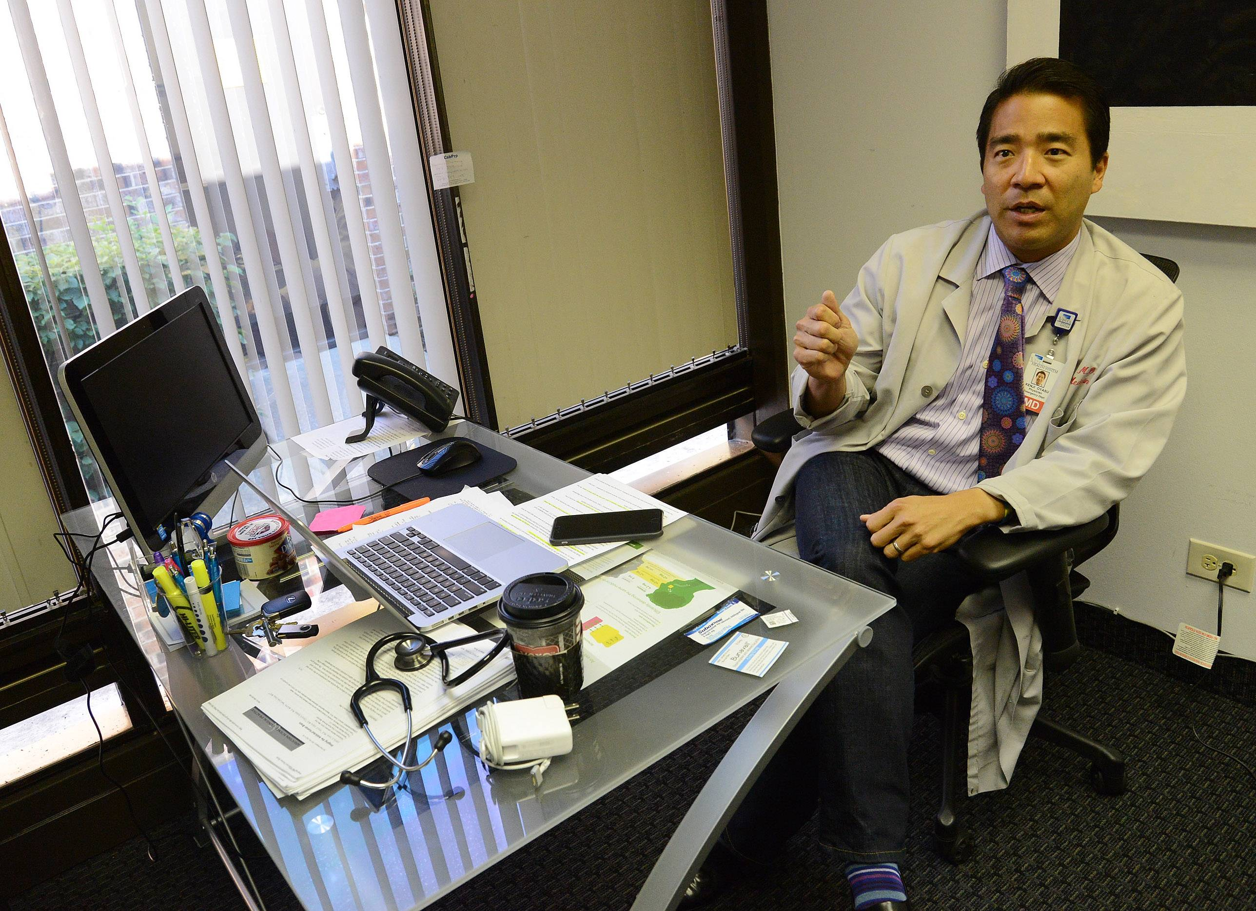 Dr. Kenji Oyasu prescribes buprenorphine, one of three main FDA-approved medications to treat heroin and opioid addiction, to patients at Brightside Clinic in Northbrook, which he opened in May 2015.