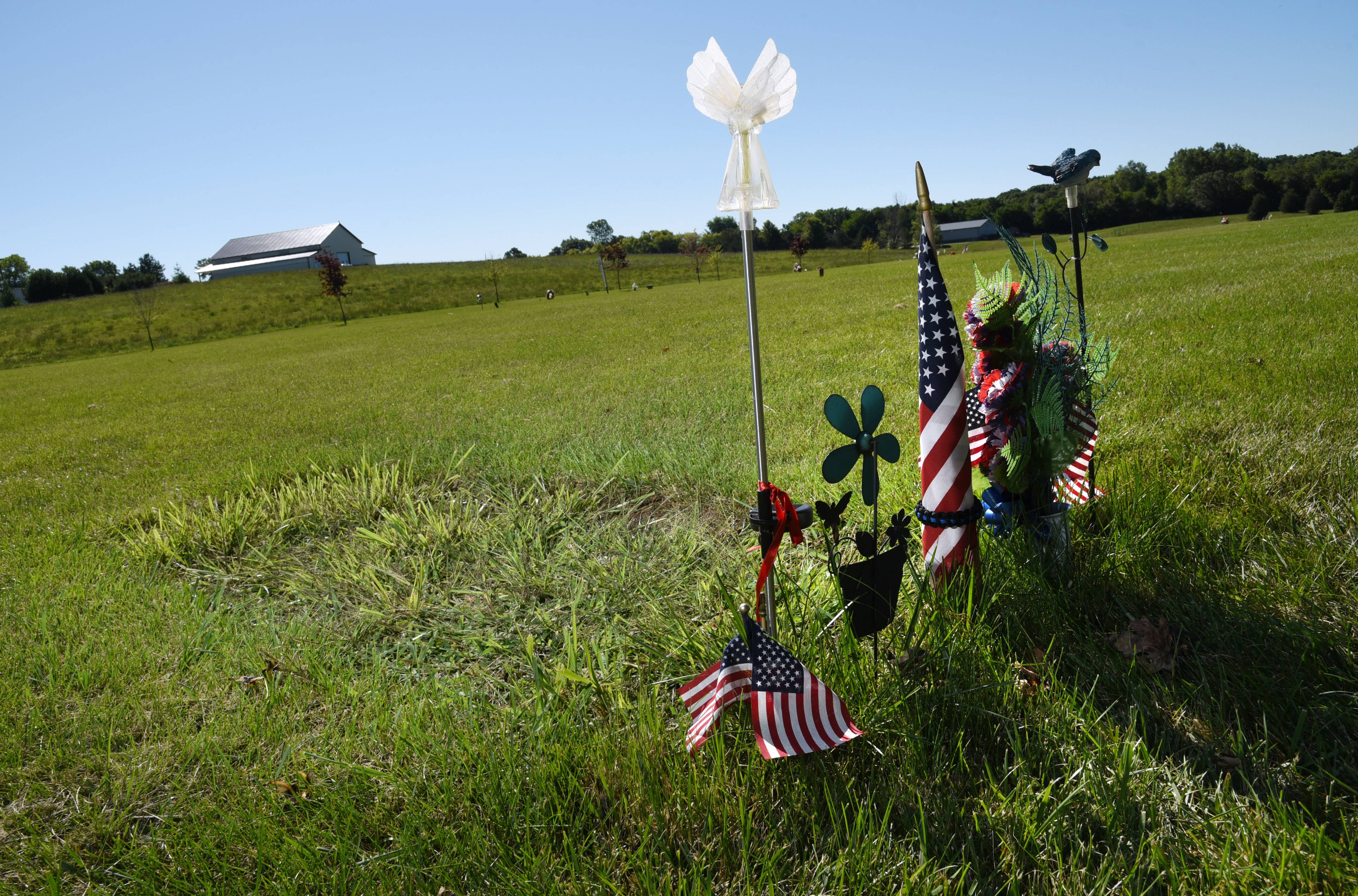 The isolation Lt. Charles Joseph Gliniewicz apparently felt at the end of his life remains a year after his death. His grave, marked only by decorations and a new crop of crab grass, sits in an empty section of Hillside Cemetery East in Antioch.