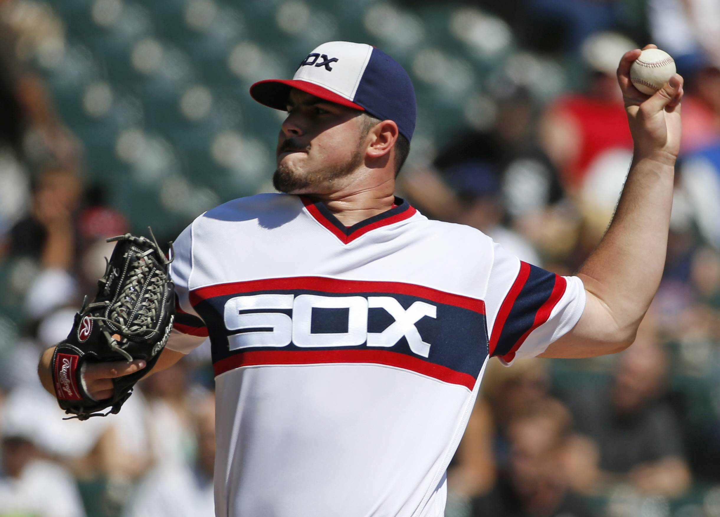 Chicago White Sox starter Carlos Rodon throws against the Seattle Mariners during the first inning of a baseball game in Chicago, Sunday, Aug. 28, 2016.