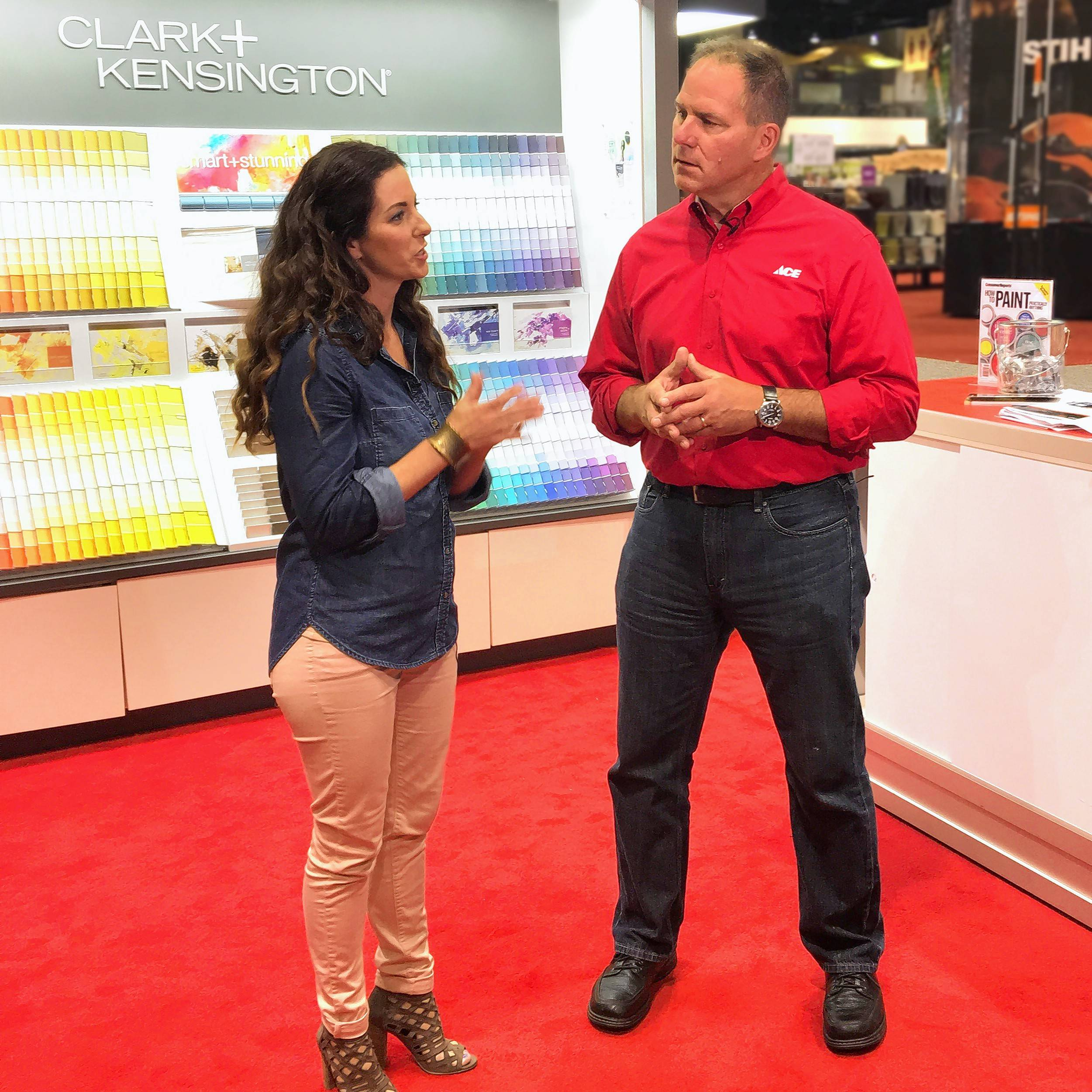 COURTESY OF ACE HARDWAREKatie Reynolds, Ace Hardware's Design Expert, at left, and Lou Manfredini, Ace Hardware's home expert talk during the Ace Retailer Convention last week at McCormick Place in Chicago.