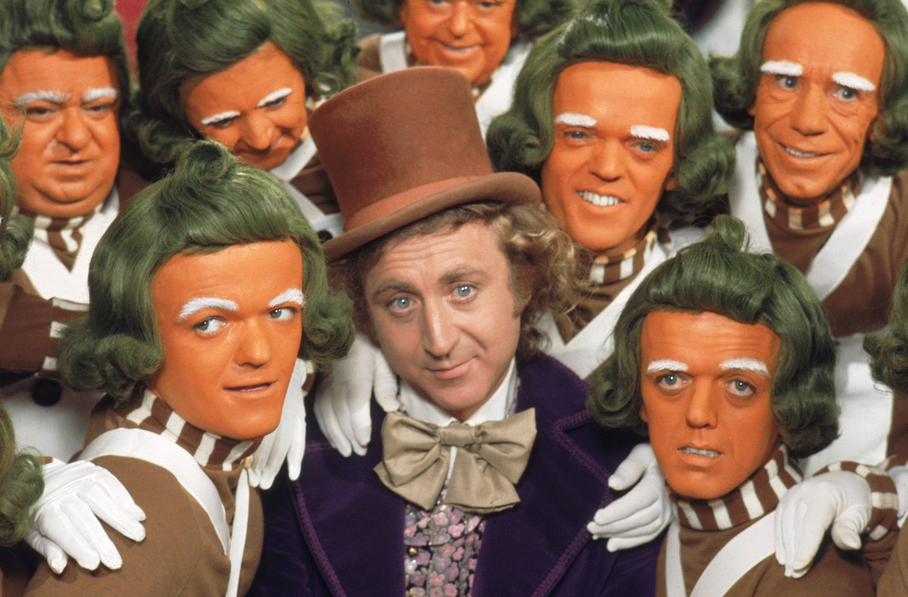"Gene Wilder amid actors as Oompa Loompas in the 1971 film ""Willy Wonka and the Chocolate Factory."""