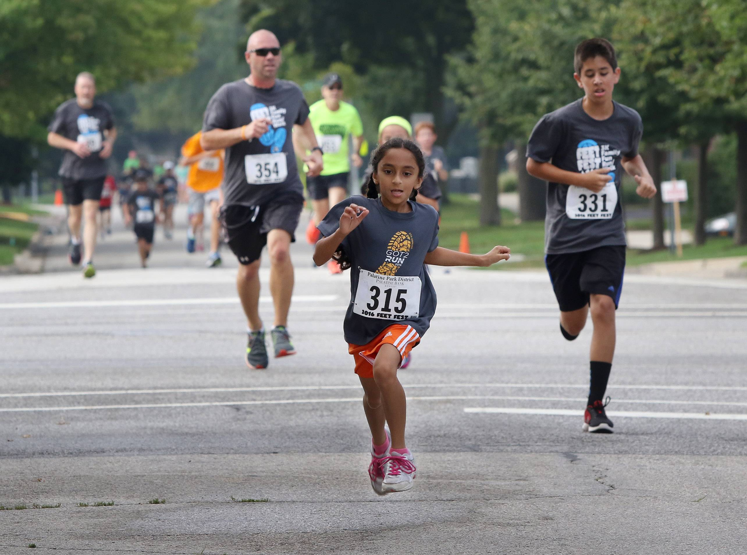Sia Purohit, 9, of Hoffman Estates sprints across the finish line during the Palatine Feet Fest 5K run on Sunday at Towne Square. The event was sponsored by the Palatine Park District in association with the Downtown Palatine Street Fest.